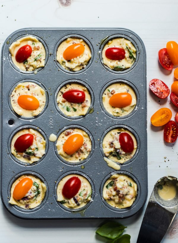 Egg Mixture in muffin tin ready to bake