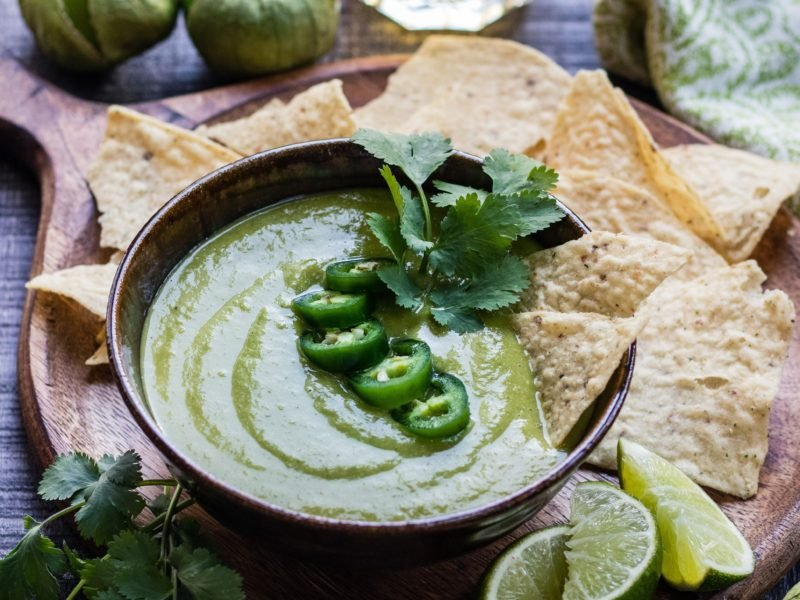 Roasted Tomatillo Salsa Verde | Give it Some Thyme - this quick and easy recipe has a sweet, spicy flare that's more than an amazing chip dip. You'll want to put it on everything! #salsaverde #salsaverderecipe #salsaverdetomatillo #salsaverdemexicana #roastedsalsaverde #roastedsalsaverderecipe #roastedtomatillosalsa #roastedtomatillosalsaverde #roastedtomatillos #salsa #chipdip #giveitsomethyme