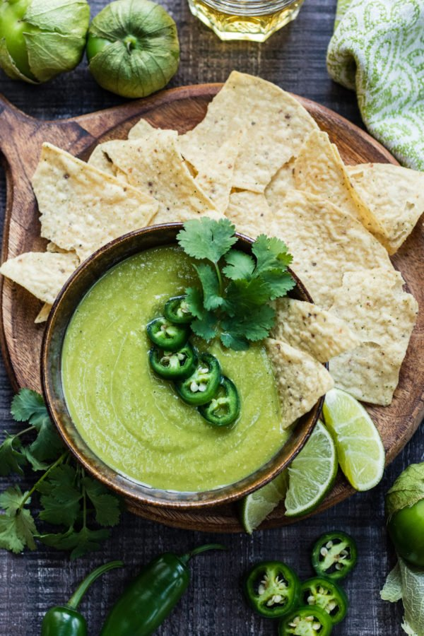 Roasted Tomatillo Salsa Verde | giveitsomethyme.com - this quick and easy recipe has a sweet, spicy flare that's more than an amazing chip dip. You'll want to put it on everything! #salsaverde #salsaverderecipe #salsaverdetomatillo #salsaverdemexicana #roastedsalsaverde #roastedsalsaverderecipe #roastedtomatillosalsa #roastedtomatillosalsaverde #roastedtomatillos #salsa #chipdip #giveitsomethyme
