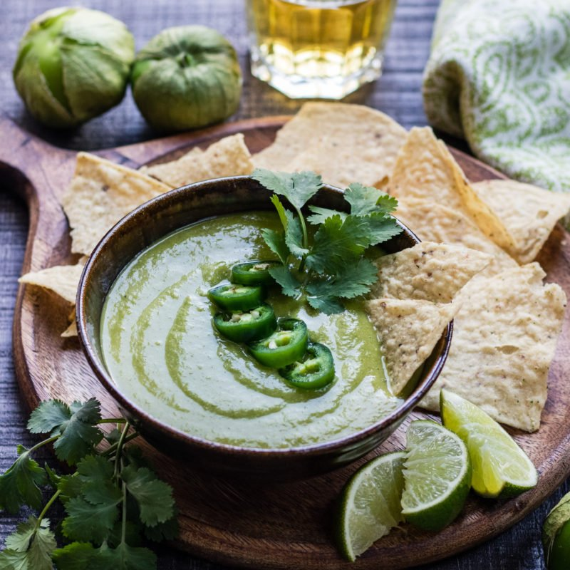 Roasted Tomatillo Salsa Verde - Give it Some Thyme - this quick and easy recipe has a sweet, spicy flare that's more than an amazing chip dip. You'll want to put it on everything! #salsaverde #salsaverderecipe #salsaverdetomatillo #salsaverdemexicana #roastedsalsaverde #roastedsalsaverderecipe #roastedtomatillosalsa #roastedtomatillosalsaverde #roastedtomatillos #salsa #chipdip #giveitsomethyme