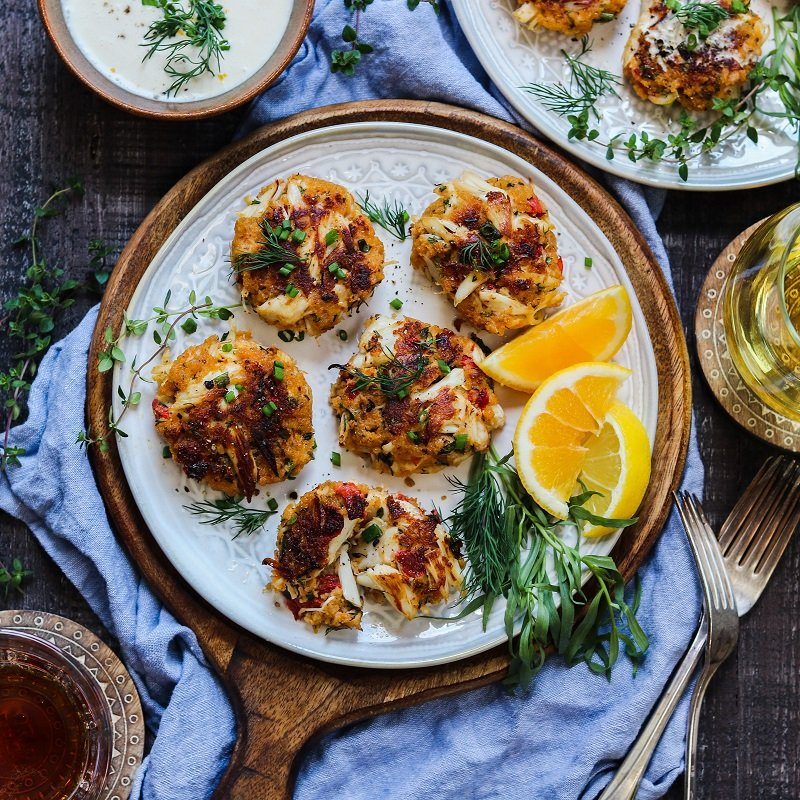 Jumbo Lump Crab Cakes w/ White Wine Meyer Lemon Sauce – succulent high lump crab-to-breading ratio cakes served with a silky, luscious citrusy sauce. #appetizers #springrecipe #summerrecipe #lightdinners #lightdinnersforsummer #crabcakes #crabcakesrecipe #meyerlemon #chardonnaysauce #winesauce #giveitsomethyme | giveitsomethyme.com