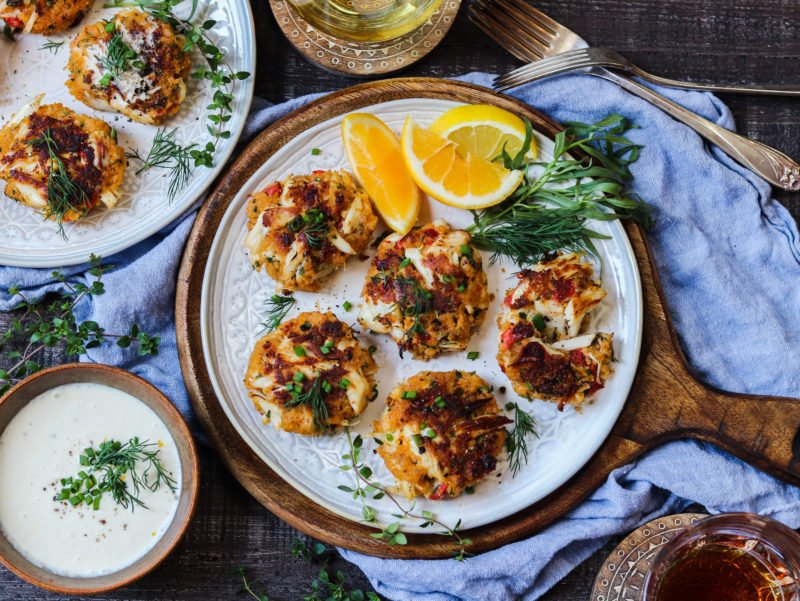 Jumbo Lump Crab Cakes with White Wine Meyer Lemon Sauce – succulent high lump crab-to-breading ratio cakes served with a silky, luscious citrusy sauce. #appetizers #springrecipe #summerrecipe #lightdinners #lightdinnersforsummer #crabcakes #crabcakesrecipe #meyerlemon #chardonnaysauce #winesauce #giveitsomethyme | giveitsomethyme.com