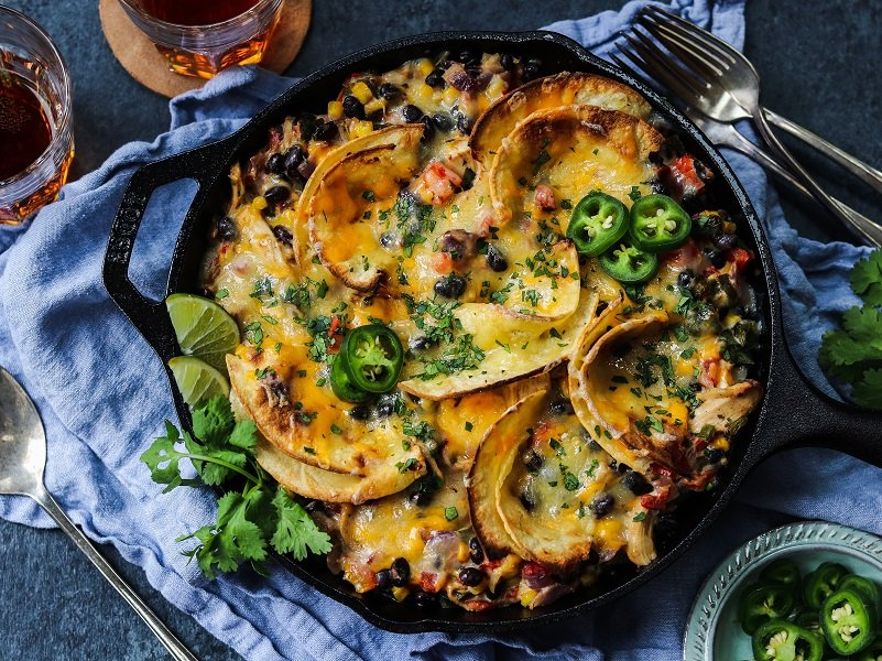 Mexican Chicken Tortilla Skillet | giveitsomethyme.com – a quick, easy, cheesy and delicious one-pan meal! #mexicanchicken #mexicanchickenskillet #mexicanchickenrecipes #cheesymexicanchickenskillet #mexicanchickentortillaskillet #chickendinner #chickendinnerrecipes #quickchickendinners #quickandeasydinner #quickandeasydinnerrecipes #giveitsomethyme