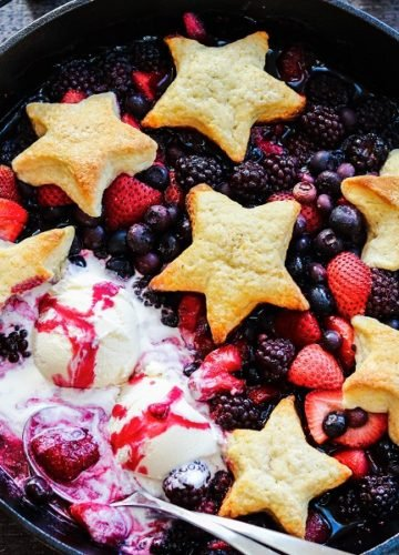Skillet Berry Cobbler with Vanilla Ice Cream - All hail the red, white, and blue with this star-spangled mixed berry cobbler! #summerdesserts #summerrecipes #cobbler #skilletcobbler #patrioticdesserts #memorialday #julyfourth #giveitsomethyme   giveitsomethyme.com