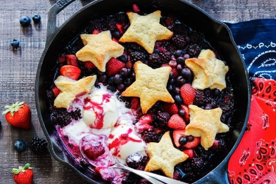Skillet Berry Cobbler with Vanilla Ice Cream - All hail the red, white, and blue with this star-spangled mixed berry cobbler! #summerdesserts #summerrecipes #cobbler #skilletcobbler #patrioticdesserts #memorialday #julyfourth #giveitsomethyme | giveitsomethyme.com