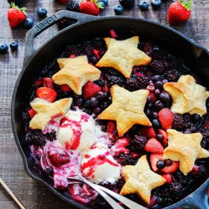 Skillet Berry Cobbler w/ Vanilla Ice Cream - All hail the red, white, and blue with this star-spangled mixed berry cobbler! #summerdesserts #summerrecipes #cobbler #skilletcobbler #patrioticdesserts #memorialday #julyfourth #giveitsomethyme | giveitsomethyme.com