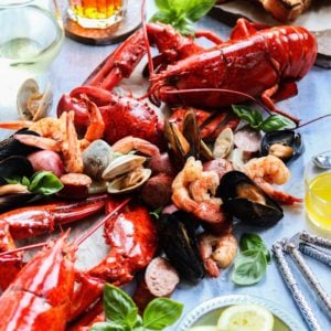 Easy Summer Kitchen Clambake – easily create your own one-pot seafood feast right in your own kitchen! #clambake #clambakeparty #newenglandclambake #seafoodboil #seafooddinner #easydinnerrecipes #onepotmeals #ketorecipes #healthydinnerrecipes #summerrecipes #giveitsomethyme   giveitsomethyme.com