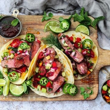 Spicy Glazed Lamb Tacos w/ Mediterranean Salsa – tender lamb loin coated in a sweet n' spicy orange marmalade glaze, grilled to perfection, and topped with a refreshing tomato-cucumber salsa! #tacos #lambtacos #lambloinrecipes #greekrecipes #quickandeasydinners #healthydinners #ketorecipes #summerrecipes #giveitsomethyme | giveitsomethyme.com