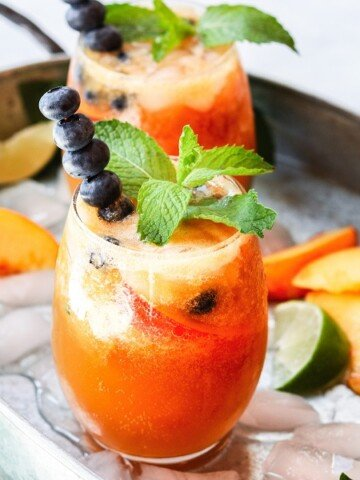 Gingered Peach and Blueberry Mojitos - beat the heat with a refreshingly flavorful twist to the classic cocktail! #mojitos #cocktails #cocktailrecipes #mocktails #peachrecipes #blueberries #summerrecipes #giveitsomethyme   giveitsomethyme.com