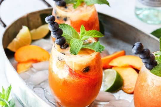 Gingered Peach and Blueberry Mojitos - beat the heat with a refreshingly flavorful twist to the classic cocktail! #mojitos #cocktails #cocktailrecipes #mocktails #peachrecipes #blueberries #summerrecipes #giveitsomethyme | giveitsomethyme.com