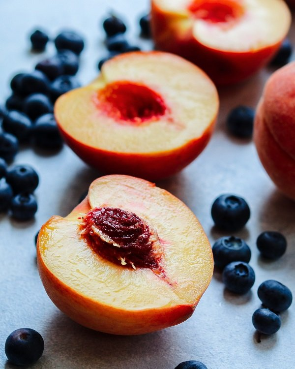 Halved Peaches and Blueberries