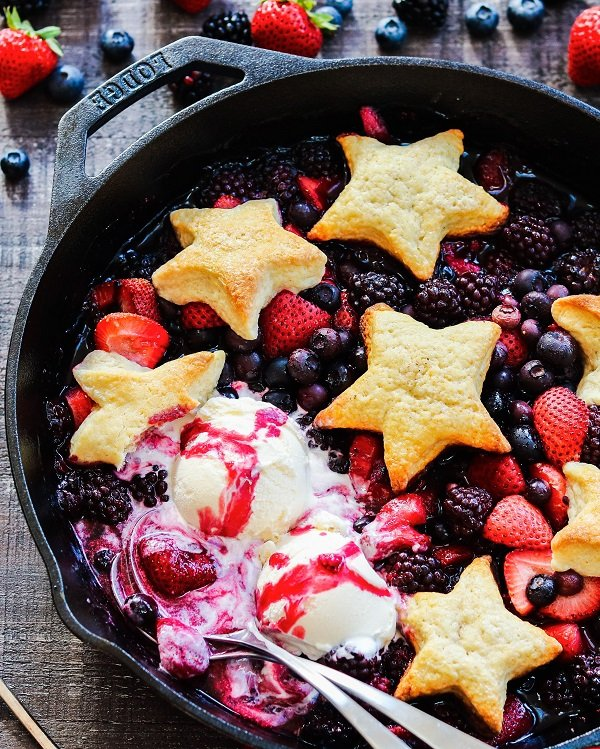 4th of July Party Menu Ideas   Skillet Berry Cobbler - All hail the red, white, and blue with this star-spangled mixed berry cobbler! #summerdesserts #summerrecipes #summerdessertrecipes #cobbler #skilletcobbler #berryskilletcobbler #patrioticdesserts #memorialday #memorialdaydesserts #julyfourth #july4thfood #giveitsomethyme   giveitsomethyme.com