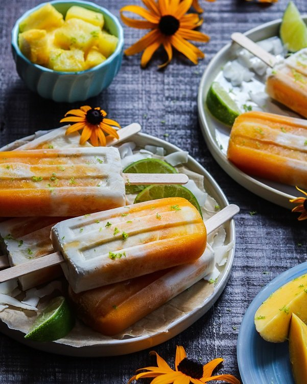 Mango Pineapple Coconut Popsicles – vegan and refined sugar-free tropical popsicles that scream summer! #popsicles #healthypopsicles #homemadepopsicles #fruitpopsicles #tropicalpopsiciles #frozendesserts #nobakedesserts #vegandesserts #sugarfreedesserts #summerrecipes #giveitsomethyme | giveitsomethyme.com