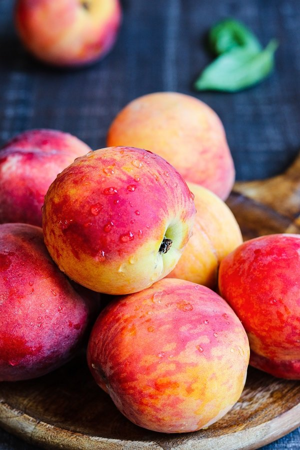 Peaches on wooden board