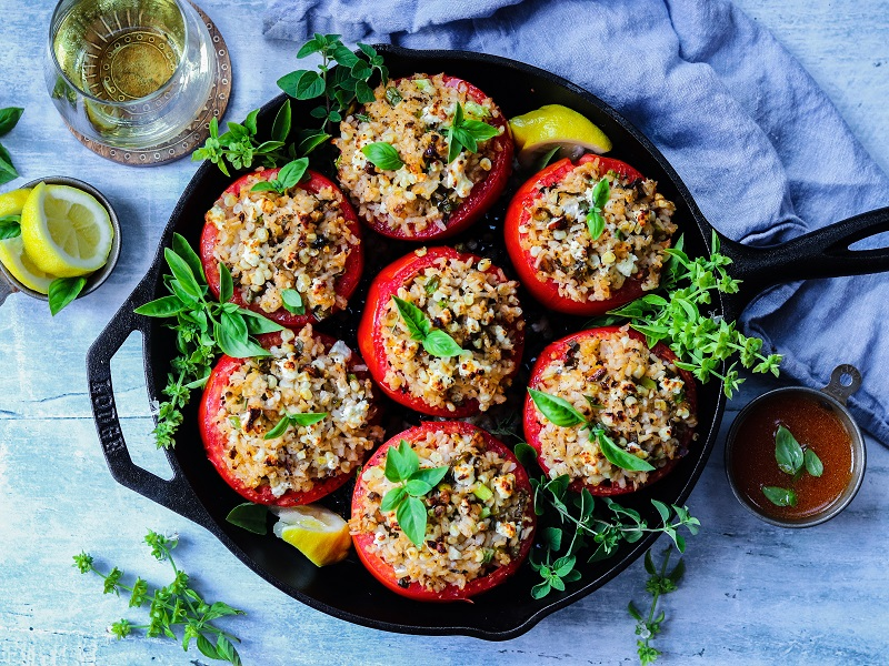 Mediterranean Rice Stuffed Tomatoes – make the most of peak season tomatoes stuffed with brown rice, roasted corn, green onion, feta and pistachios. Vegetarian & Gluten Free! #stuffedtomatoes #stuffedtomatoeshealthy #summerrecipes #mediterraneanrecipes #vegetariansides #easyrecipes #vegetarianmealprep #glutenfreerecipes #giveitsomethyme | giveitsomethyme.com