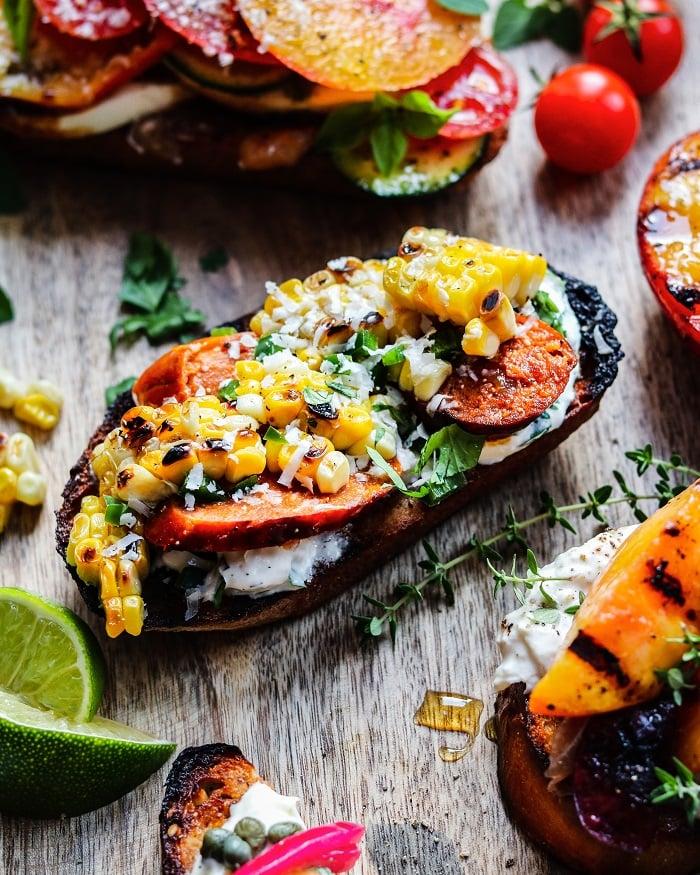 Grilled Mexican Street Corn & Chorizo Crostini with crema Mexicana, queso fresco, cotija, jalapeno, cilantro and lime #crostini #cornrecipes #mexicanrecipes #appetizers #giveitsomethyme | giveitsomethyme.com