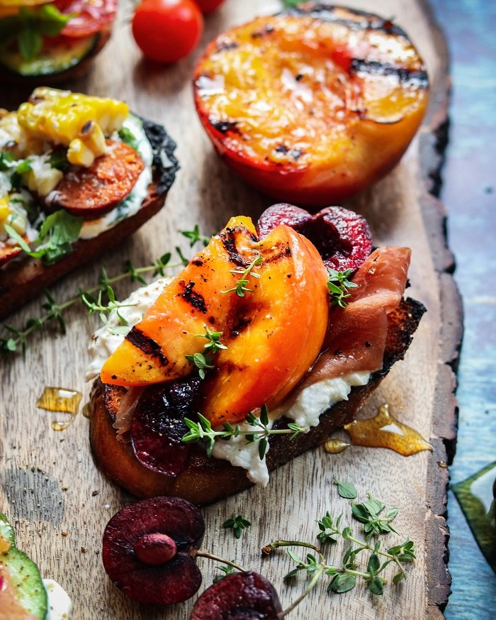 Tuscan Stone Fruit & Prosciutto Crostini with burrata, thyme and honey #crostini #peachrecipes #cherryrecipes #appetizers #giveitsomethyme | giveitsomethyme.com