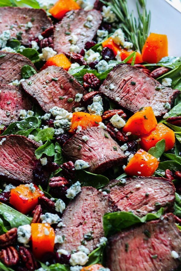 Mocha-Rubbed Steak & Spinach Salad – Move into fall by topping this juicy, spice-rubbed steak and fresh spinach with roasted squash, dried cranberries and pecans, then drizzle with a white balsamic rosemary vinaigrette! #steaksalad #steakandspinachsalad #butternutsquash #fallrecipes #healthyfalldinners #ketodinnerrecipes #glutenfreerecipes #giveitsomethyme | giveitsomethyme.com