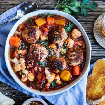 Spicy Turkey Meatball Stew w/ Fall Veggies – Healthy, fall comfort food! A one-pot, tomato-based stew loaded with tender turkey meatballs, butternut squash, carrots and cauliflower! #turkeyrecipes #turkeymeatballs #stews #fallrecipes #healthydinners #mealprep #freezerfriendly #onepotrecipes #onepotmeals #gamedayfood #giveitsomethyme | giveitsomethyme.com
