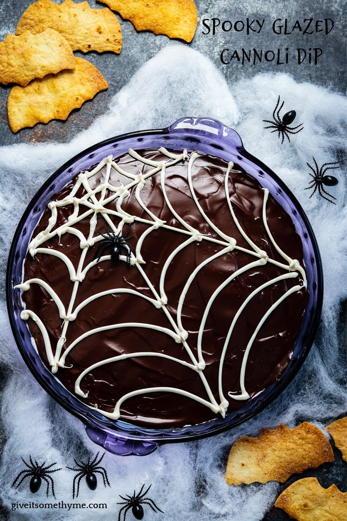 Spooky Chocolate-Glazed Cannoli Dip - Kids of all ages will love this easy Dark Chocolate Glazed Cannoli Dip loaded with mini chocolate chips! Make it ahead for an easy and irresistible Halloween treat! #cannolidip #bestcannolidip #halloweendesserts #halloweentreats #makeaheaddesserts #dessertsforparties #giveitsomethyme | giveitsomethyme.com