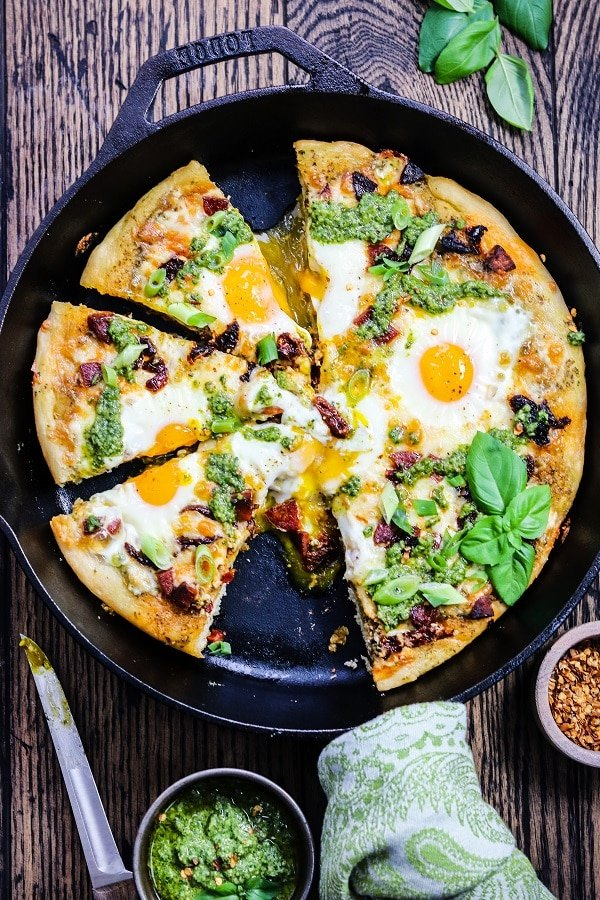Skillet Breakfast Pesto Pizza – A deep-dish style skillet pizza topped with gooey eggs, creamy jack cheese, chorizo, sun-dried tomatoes, and spinach walnut pesto! #pizza #breakfastpizza #skilletpizza #pizzadough #skilletpizzacastiron #pestopizza #skilletrecipes #breakfast #brunch #gamedayfood #giveitsomethyme | giveitsomethyme.com