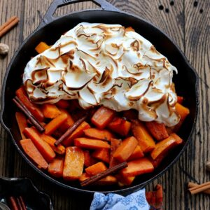 Cider Glazed Sweet Potatoes & Squash   Give it Some Thyme - sweet potatoes and butternut squash bathe in an apple cider and maple syrup glaze infused with fall spices then topped with a fluffy meringue! #sweetpotatorecipes #sweetpotatocasserole #ciderglazedsweetpotatoes #butternutsquash #skilletrecipes #fallrecipes #thanksgivingsides #thanksgivingsidedishes #giveitsomethyme