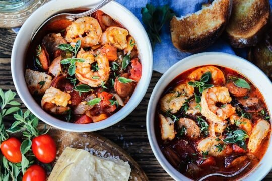 Chicken Shrimp and Sausage Stew | Give it Some Thyme – Land and sea come together deliciously in this Spanish-influenced, gluten-free one-pot wonder! #chickenstew #spanishchickenstew #easychickenstew #shrimpstew #spanishshrimpstew #stewrecipes #dinner #sausagestew #chickensausagestew #comfortfood #superbowlfood #onepotmeals #onepotrecipes #glutenfreerecipes #giveitsomethyme