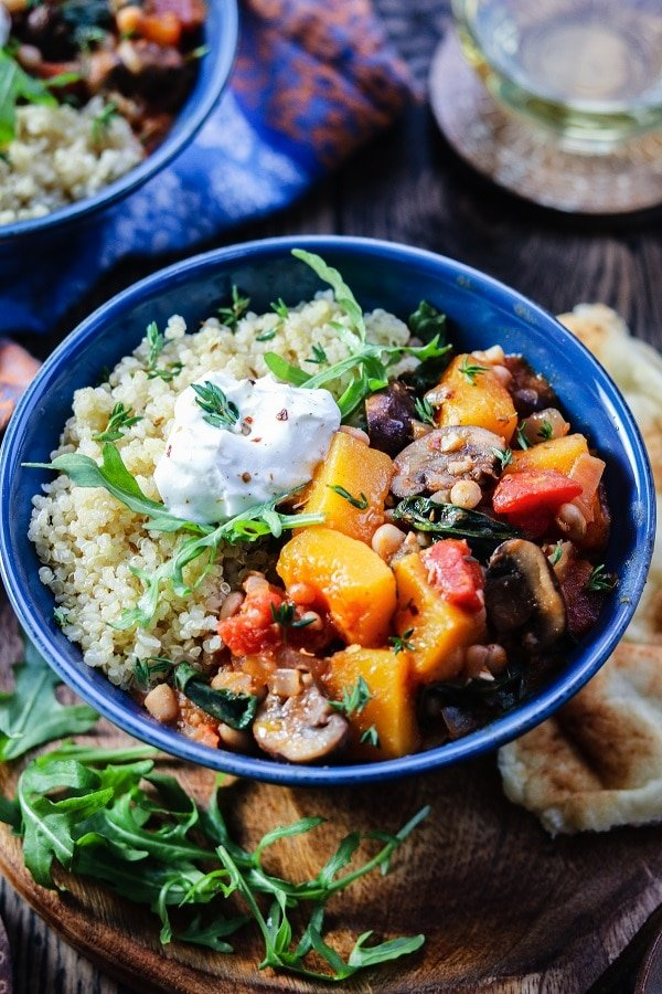 This Moroccan Butternut Squash Stew full of mushrooms, arugula, white beans, tomatoes and spices is what healthy, hearty comfort food is all about.