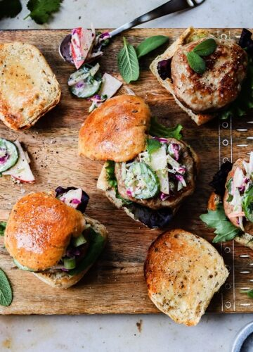 Turkey Sliders with Apple Rainbow Slaw - Take burger night to another level with these super tasty, quick and easy Turkey Sliders topped with a creamy and crunchy Apple Rainbow Slaw! #turkeysliders #turkeyburgers #burgers #sliders #applecoleslaw #sandwiches #lowfatrecipes #gamedayfood #superbowlfood #giveitsomethyme | giveitsomethyme.com