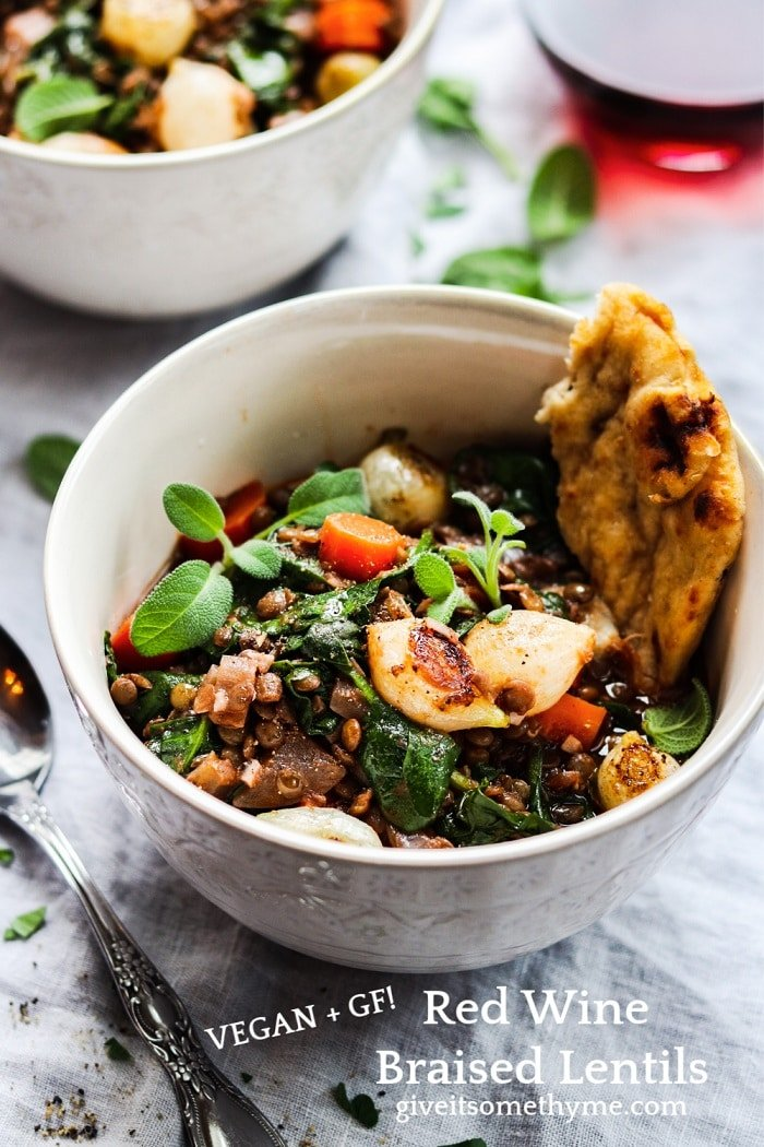 Red Wine Braised Lentils with Spinach & Pearl Onions | Give it Some Thyme - This hearty stew is chock-full of nutrients and rich, earthy flavor. Vegan comfort food at its finest! #lentils #lentilsrecipe #braisedlentils #spinachrecipe #frenchgreenlentils #lentilsandspinach #vegan #veganstew #glutenfree #healthydinnerrecipes #lowfatrecipes #giveitsomethyme