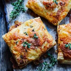 Bangers and Sweet Potato Mash Hand Pies - zesty sausage, creamy mashed sweet potatoes and Irish cheddar swaddled in golden, flaky puff pastry! #bangersandsweetpotatomash #handpies #bangersandmash #bangersandmashappetizer #bangersandmashhandpies #handpiessavory #stpatricksdayfood #stpaddysdayfood #giveitsomethyme | giveitsomethyme.com