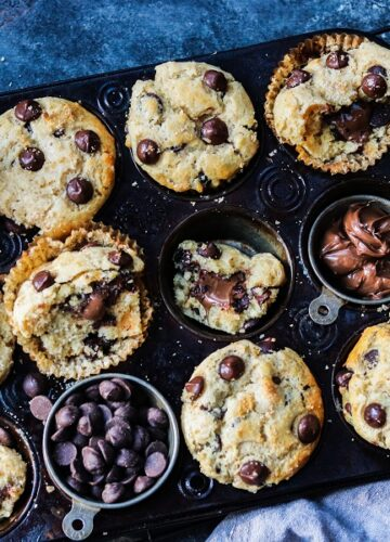 Nutella Stuffed Chocolate Chip Muffins – Moist and delicious, easy homemade muffins loaded with dark chocolate chips and generously stuffed with Nutella! #muffins #chocolatechipmuffins #chocolatechipmuffinseasy #homemademuffins #nutellarecipes #nutellastuffedmuffins #nutellastuffed #pantryrecipes #giveitsomethyme | giveitsomethyme.com