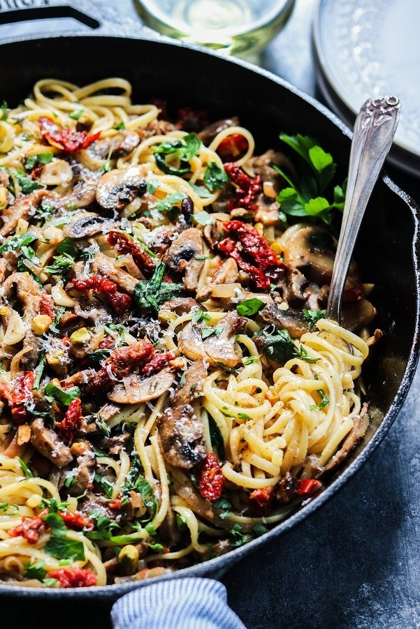 Buttery Pantry Pasta with Mushrooms & Sun-Dried Tomatoes – With some simple veggies, butter, a hunk of parm, and a couple things from the pantry, a delicious pasta dinner is just 30 minutes away. #pastadinner #linguine #linguinerecipeseasy #pantryrecipes #budgetmeals #vegetarianmeals #quickandeasydinner #30minutemeals #giveitsomethyme | giveitsomethyme.com
