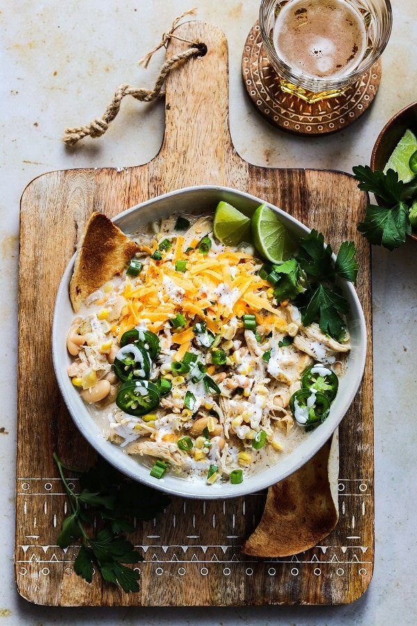 Cheesy Crockpot White Chicken Chili - Such an easy, delicious, set-and-forget crockpot recipe made with ingredients you most likely already have in your pantry and fridge! #chili #whitechickenchili #whitechickenchilicrockpot #slowcookerrecipes #crockpotrecipes #whitechickenchilieasy #mexicanrecipes #cincodemayorecipes #glutenfreerecipes #pantryrecipes #budgetmeals #giveitsomethyme | giveitsomethyme.com