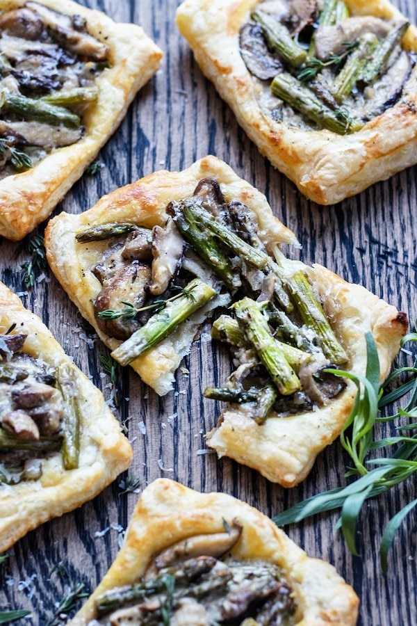 Asparagus Mushroom & Goat Cheese Pastry Tarts | Give it Some Thyme – an easy and delicious appetizer or side dish you can prep ahead! #asparagusrecipes #asparagustarts #springrecipes #mothersdayrecipes #puffpastryrecipes #asparagusmushroomtart #vegetarianappetizers #vegetariansides #vegetariansidedishes #giveitsomethyme