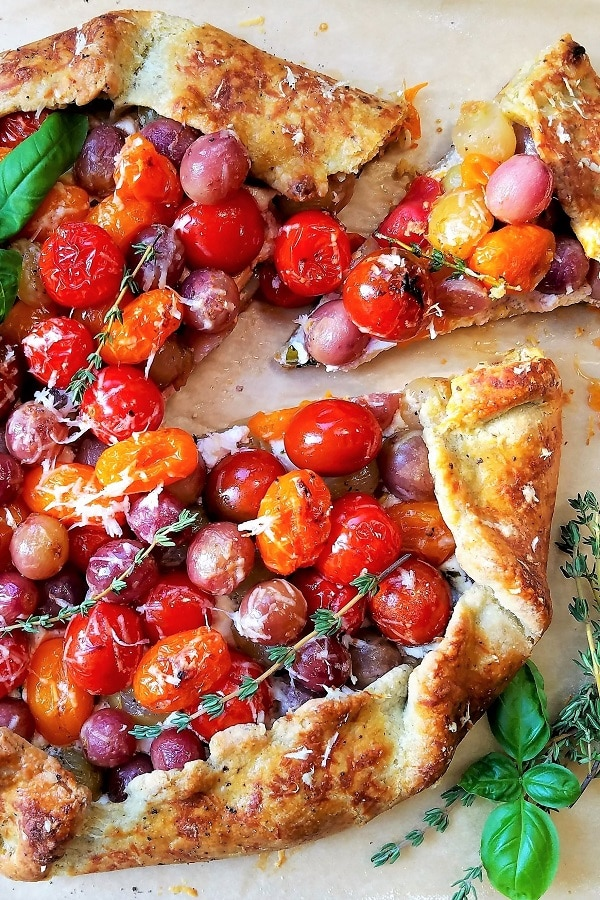 Blistered Cherry Tomato and Grape Galette | Give it Some Thyme – a delicious tomato and grape galette recipe with whipped ricotta and goat cheese all swaddled in a savory herb crust! #tomatogalette #cherrytomatogalette #tomatogaletterecipe #grapegalette #galette #galetterecipesavory #mothersdayrecipes #giveitsomethyme