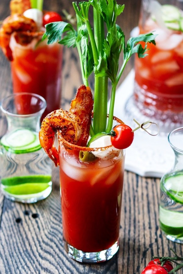 Bloody Mary w/ Cucumber-Lime Vodka - giveitsomethyme.com - add cool, citrusy flavor with cucumber-lime infused vodka in this heavily garnished Bloody Mary. A cocktail and appetizer all in one! #bloodymary #bloodymaryrecipe #bloodymarymix #bloodymaryeasy #cucumberlimebloodymary #cucumberlimevodka #cocktails #mothersdaybrunch #mothersdayrecipes #giveitsomethyme