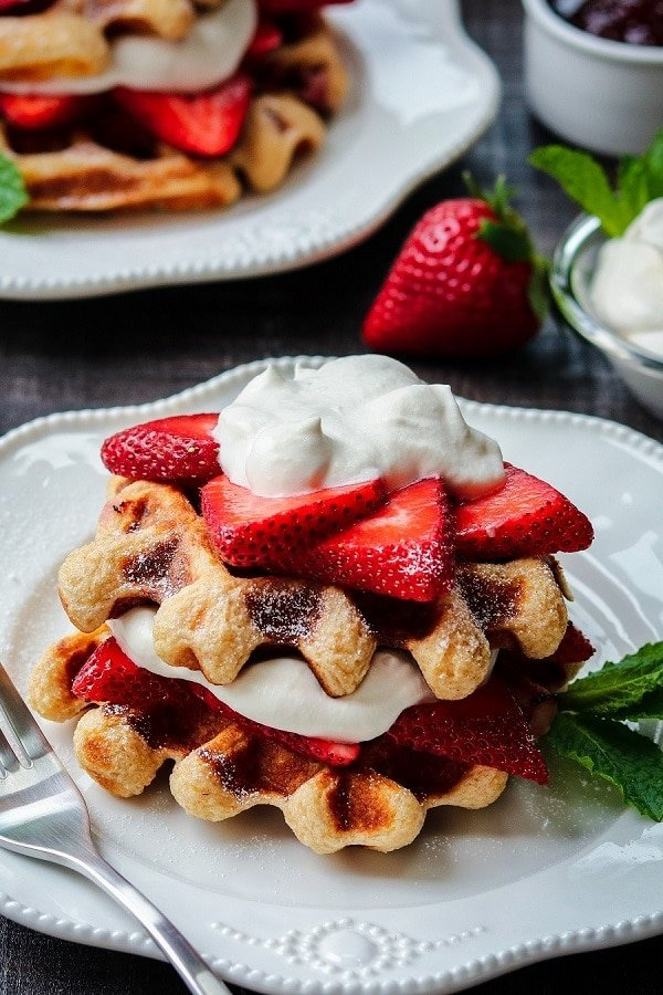 Strawberry Shortcake Buttermilk Waffles | Give it Some Thyme – delicious, crisp yet tender buttermilk waffles layered with fresh strawberries and dollops of maple whipped cream! #waffles #strawberrywaffles #stawberryshortcake #strawberryshortcakewaffles #breakfast #brunch #mothersdaybrunch #giveitsomethyme