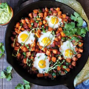 Sweet Potato Hash with Baked Eggs & Avocado Cilantro Crema | Give it Some Thyme - breakfast, lunch, or dinner, this gluten-free, one-skillet recipe is a hearty, delicious meal anytime of day!