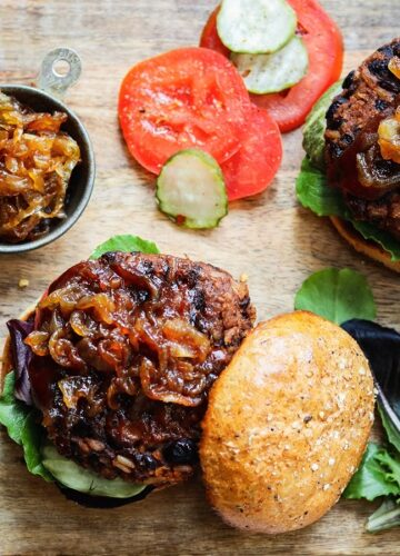Vegan BBQ Bean Burgers w/ Caramelized Onions – Delicious, nutrition-packed bean burgers made with pantry ingredients and can be grilled! #recipe #veganburgers #beanburgers #blackbeanburgers #veggieburgers #grillableveggieburger #grillableveganburger #grillableblackbeanburger #pantryrecipes #budgetrecipes #healthyburgers #memorialdayfood #giveitsomethyme | giveitsomethyme.com