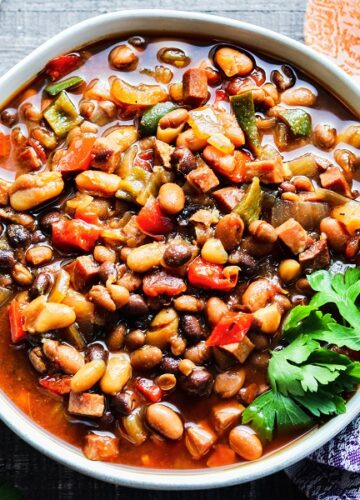 Slow Cooker Soda Baked Beans – Keep the kitchen cool with this delicious, kicked up, sweet n' spicy summer side! #bakedbeans #slowcookerbakedbeans #crockpotbakedbeans #sidedishrecipes #july4thfood #bbqsidedishes #barbecuesidedishes #glutenfree #giveitsomethyme | giveitsomethyme.com