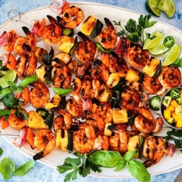 Spicy Adobo Shrimp Skewers with Mango Avocado Salsa | giveitsomethyme.com - Delicious skewers of shrimp, pineapple, bell and poblano peppers, and red onion coated in a smoky, sweet n' spicy glaze!