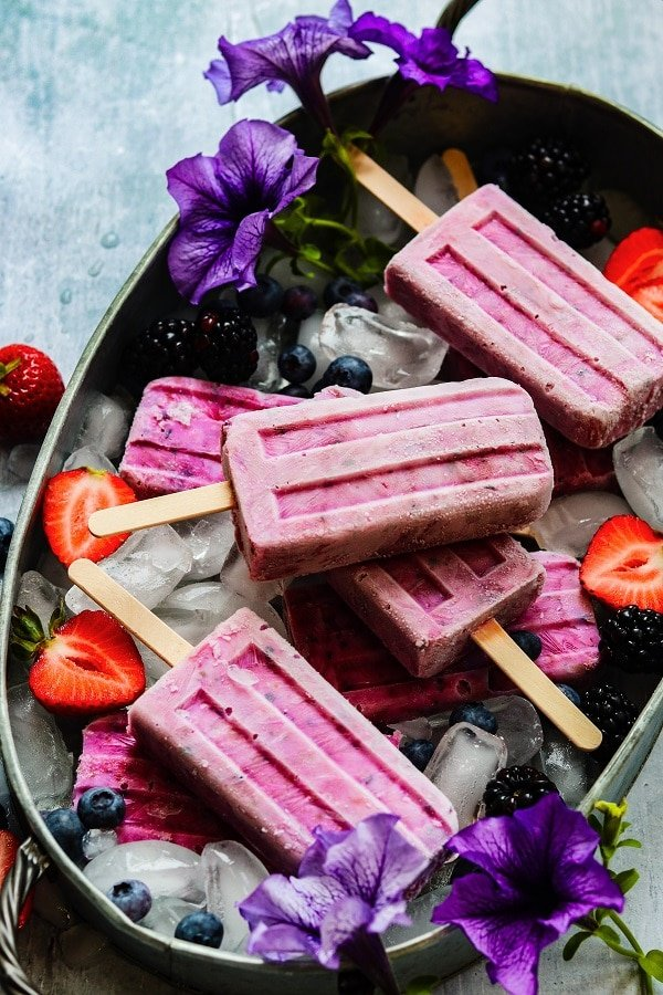 Triple Berry Yogurt Popsicles – 5 ingredients and 5 minutes is all it takes to make these healthy and delicious popsicles you can even enjoy for breakfast! #popsicles #tripleberrypopsicles #berrypopsicles #yogurtpopsicles #yogurtpops #icepops #breakfastpopsicles #healthypopsicles #frozendesserts #summerrecipes #giveitsomethyme   giveitsomethyme.com