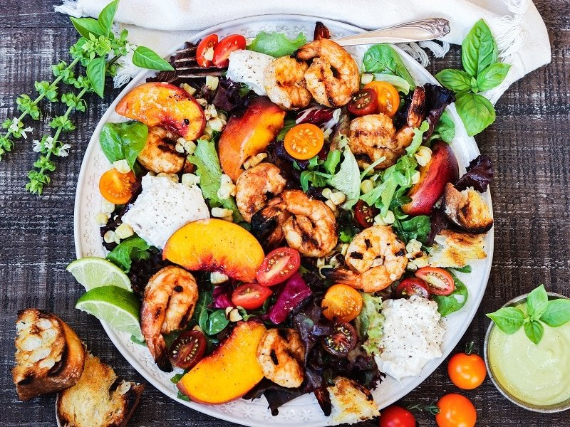 Grilled Shrimp and Peach Salad w/ Burrata and Basil - Smoky, charred shrimp and sweet peaches atop leafy greens with creamy burrata and fresh basil makes a perfect summer salad and is ready in 30 minutes!