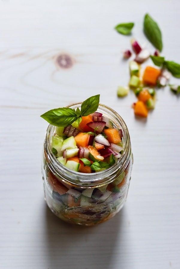 Cucumber Cantaloupe Salsa in Mason Jar garnished with basil