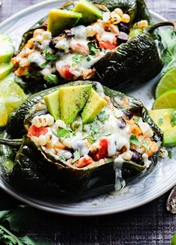 Southwest Chicken Stuffed Poblanos | giveitsomethyme.com - easy, gluten-free stuffed peppers packed with tender chicken, rice, beans and corn, oozing with cheese, and full of bold, delicious flavor. Perfect any night of the week!