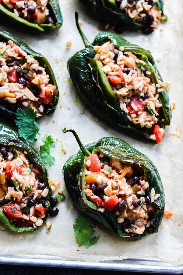 peppers filled with chicken mixture on baking sheet