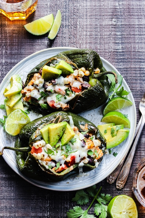 Southwest Chicken Stuffed Poblanos | giveitsomethyme.com - easy, gluten-free stuffed peppers packed with tender chicken, rice, beans and corn, oozing with cheese, and full of bold, delicious flavor. Perfect any night of the week! #stuffedpeppers #stuffedpoblanopeppers #chickenstuffedpeppers #southwestchicken #glutenfreerecipesfordinner #giveitsomethyme