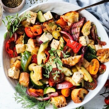 Grilled Greek Panzanella Salad | giveitsomethyme.com – an easy and delicious farmers market inspired salad featuring seasonal veggies, crusty bread and feta cheese coated in a tangy red wine vinaigrette.