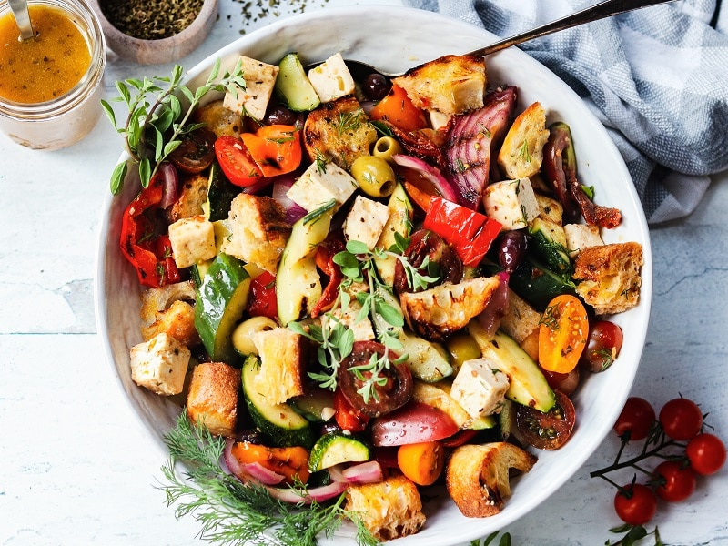 Grilled Greek Panzanella Salad | giveitsomethyme.com – an easy and delicious farmers market inspired salad featuring seasonal veggies, crusty bread and feta cheese coated in a tangy red wine vinaigrette. #salad #greeksalad #panzanellasalad #bbqsidedishes #summersalads #summerrecipes #vegetarianrecipes #giveitsomethyme